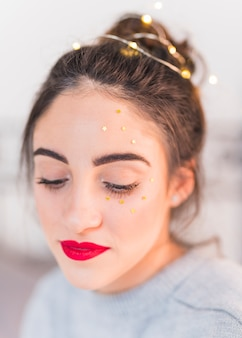 Woman with small star spangles on face