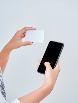 Woman with smartphone and credit card