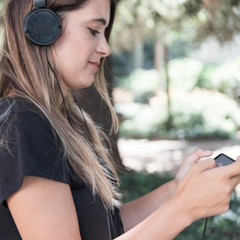 Woman with smartphone showing amazon prime video app