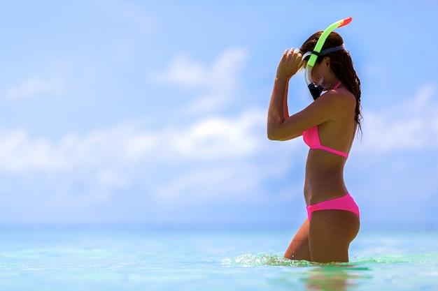 Woman with a snorkel mask in maldives