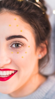 Woman with star spangles on face