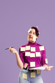 Woman with sticky notes on her looking up