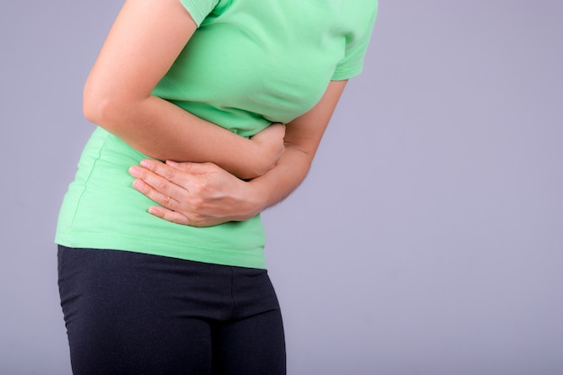Woman with stomach ache, menstrual period cramp, abdominal pain, food poisoning.