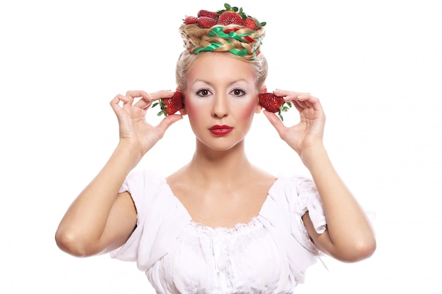 Woman with strawberry in her hairstyle