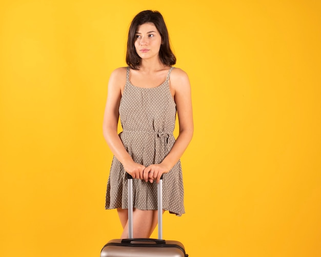 Woman with suitcase ready to go on vacation