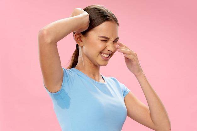 Woman with sweaty armpits