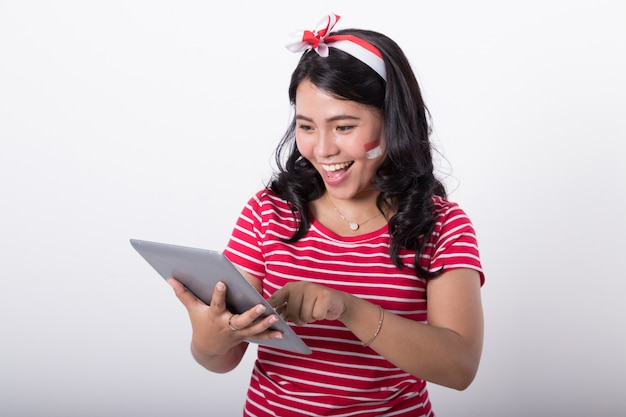 Woman with tablet on indonesian independence day celebration