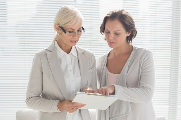 Woman with therapist reading notes