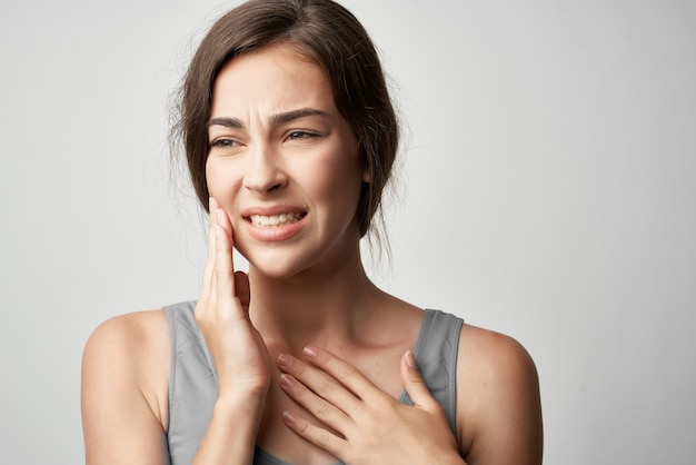 Woman with toothache medicine health problems dentistry