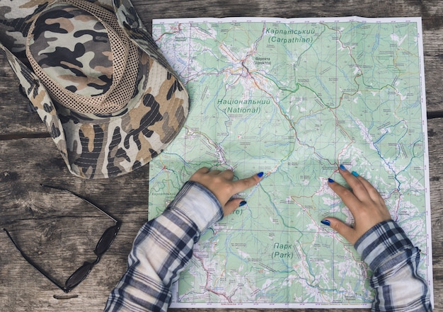 Woman with tourist map in woods