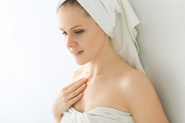 Woman with towel on head and body after shower