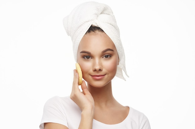 Woman with towel on head clean skin rejuvenation
