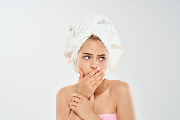 Woman with a towel on her head clean skin health emotions dermatology