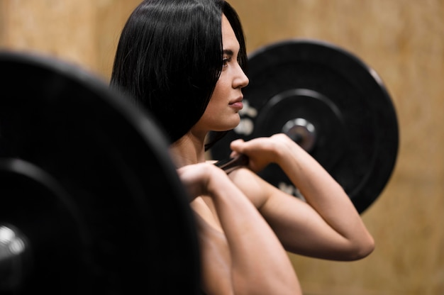 Woman with tractions bar working out