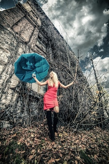 Woman with umbrella in abandoned place