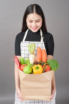 Woman with vegetables in grocery bag