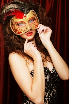 Woman with venetian masquerade carnival mask
