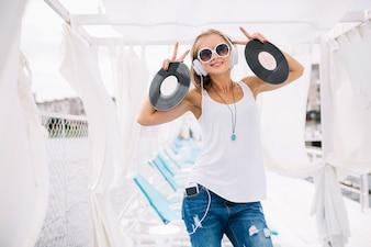 Woman with vinyl gesturing two fingers