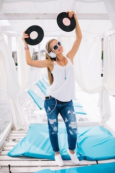 Woman with vinyl records on lounge