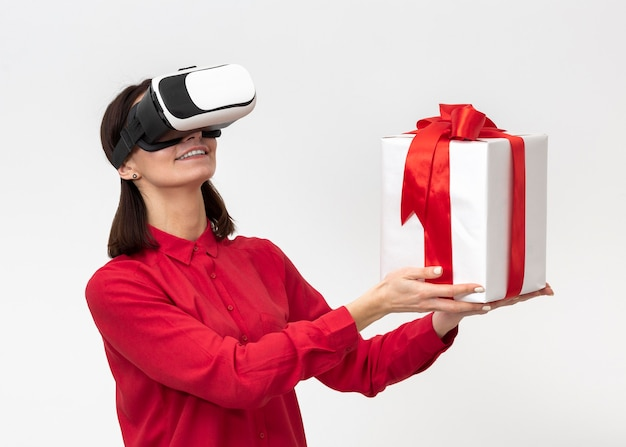 Woman with virtual reality headset holding gift box