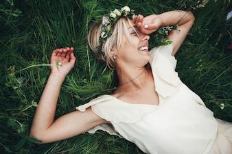 Woman with wedding dress lying on the floor