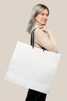 Woman with a white shopping bag with design space
