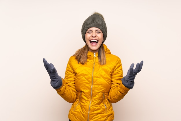 Woman with winter hat over wall unhappy and frustrated with something