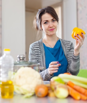 Woman with yellow pepper anf other vegetables
