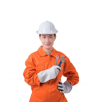 Woman worker in mechanic jumpsuit is holding a wrench