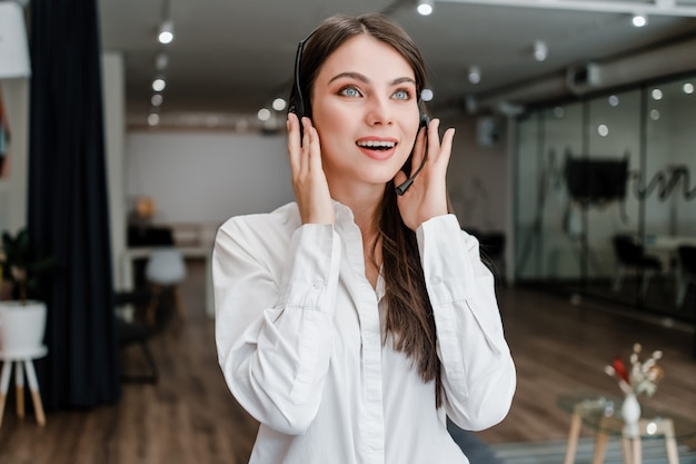 Woman working in call center as customer support operator answering calls