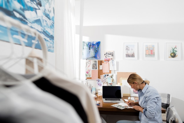 Woman working in creative workspace