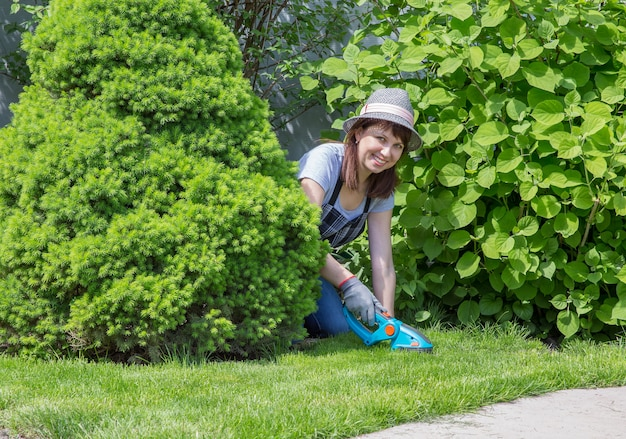 Woman working in garden in a sunny day
