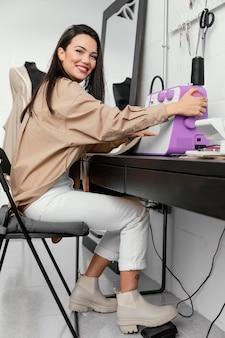Woman working in her fashion design workshop