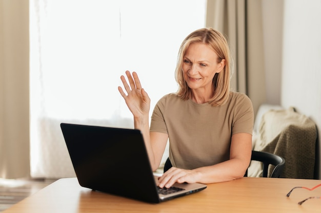 Woman working at home during quarantine with laptop