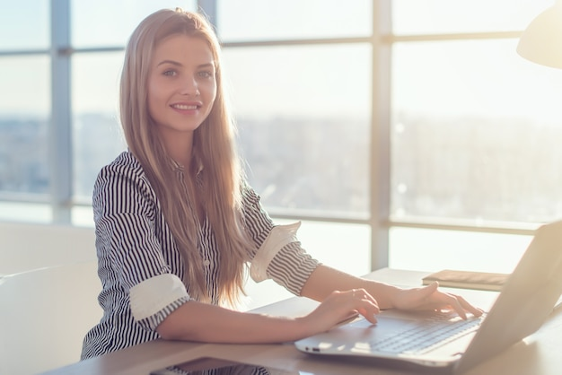 Woman working at home office hand on keyboard.