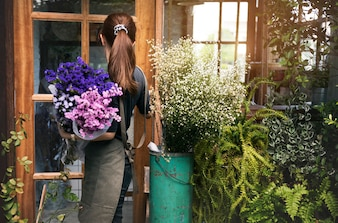 Woman working in her flower shop