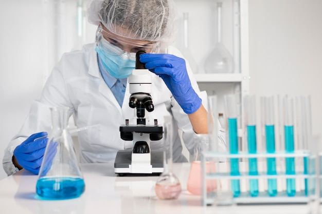 Woman working in laboratory close up