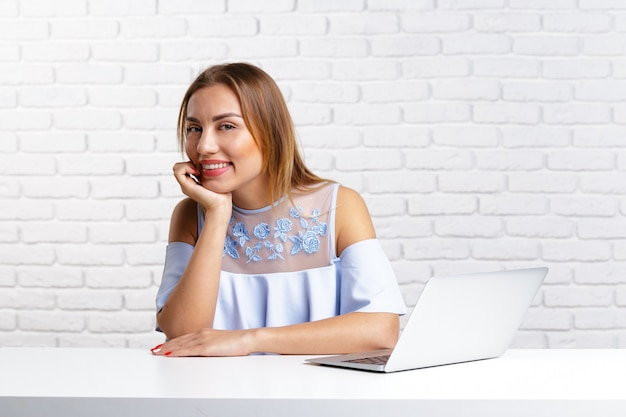 Woman working on laptop computer at office