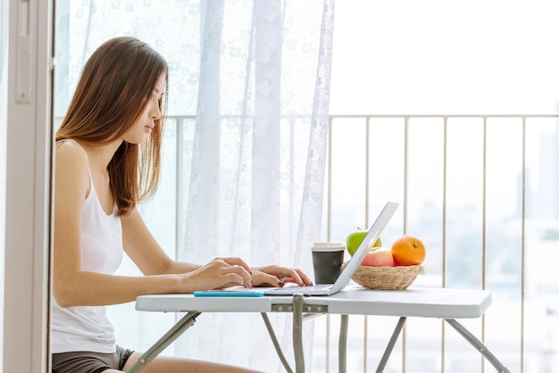Woman working on laptop outdoor at home. beautiful women connect internet outdoor working wireless internet technology
