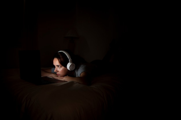 Woman working late on laptop at home