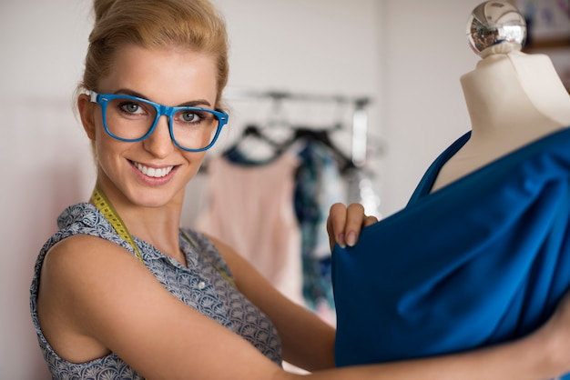 Woman working at new clothes