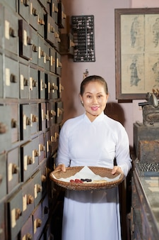 Woman working at old pharmacy