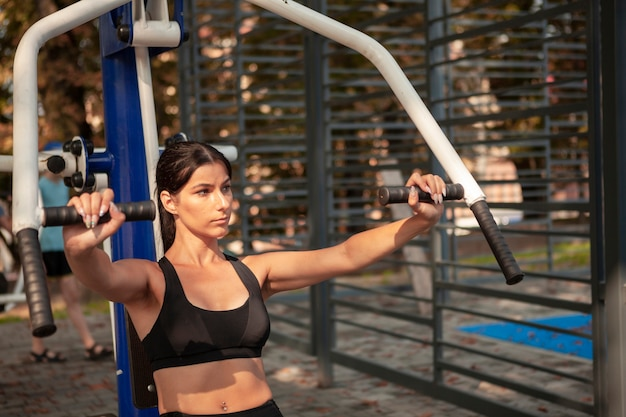 Woman working out to gain hands muscle