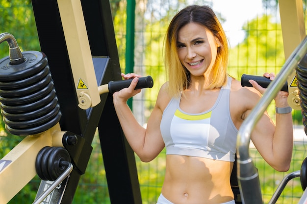 Woman working out in an outdoor gym