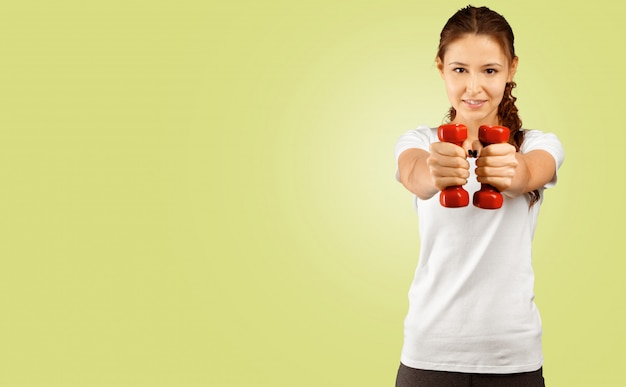 Woman working out with dumbbell and copyspace