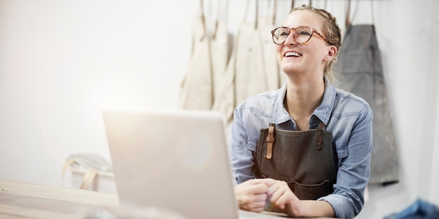 Woman working showroom smiling connection labtop concept