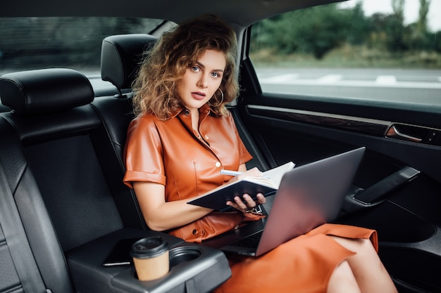 Woman working with serious emotion in car