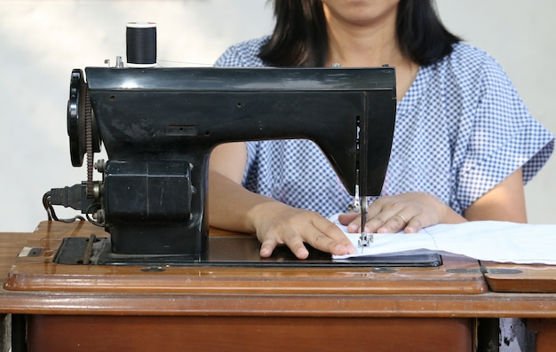Woman working with sewing machine.
