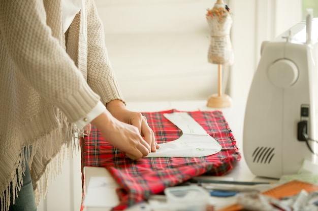 Woman working with a sewing pattern