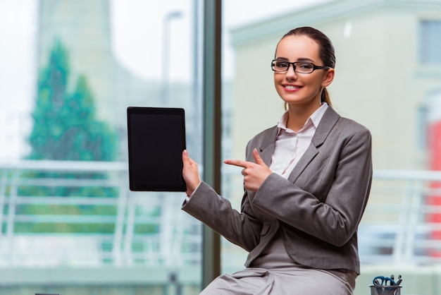 Woman working with tablet in office
